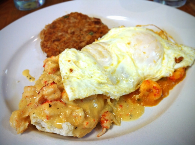 Eggs Begnaud w/Crawfish Étouffée covered Biscuts and Boudin Sausage