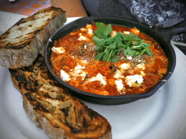 Shakshuka: 2 Farm Eggs coddled in Spicy Pepper and Tomato Ragu w/ Marinated Feta and Merguez Sausage