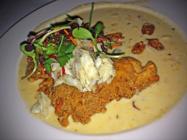 Pecan Crusted Gulf Fish A Commander's Palace classic with crushed sweet corn, spiced pecans, petite herbs, and Prosecco poached Louisiana blue crab