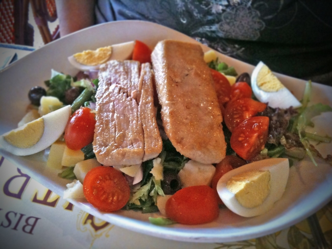 Salade Nicoise: Seared Tuna, Black Olives, Tomatoes, String Beans, Onions, Potatoes, Sliced Eggs in a Lemon Olive Oil Dressing