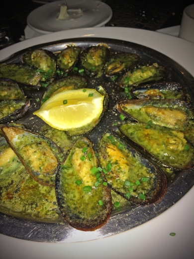 MOSSELEN GRATINÉES:  Oven-grilled mussels on the half-shell, garlic butter