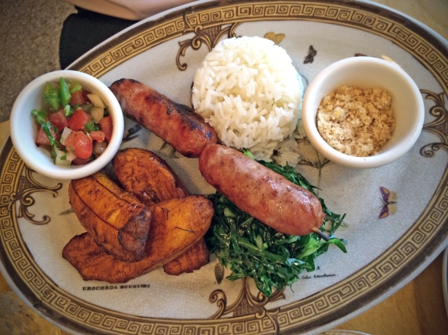 Brazilian Sausage w/rice, beans, plantains, collard greens, salsa & farofa