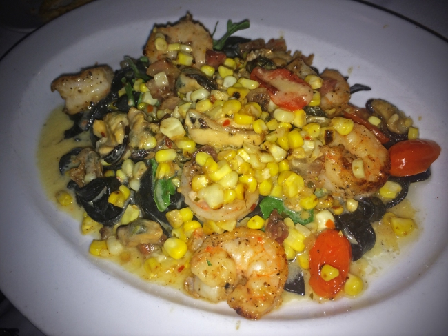"FETTUCCINE ""NERO"" Gulf Shrimp, Mussels, Charred Sweet Corn, Covey Rise Farms Tomatoes, Pancetta, Urchin-Scampi Fondue"