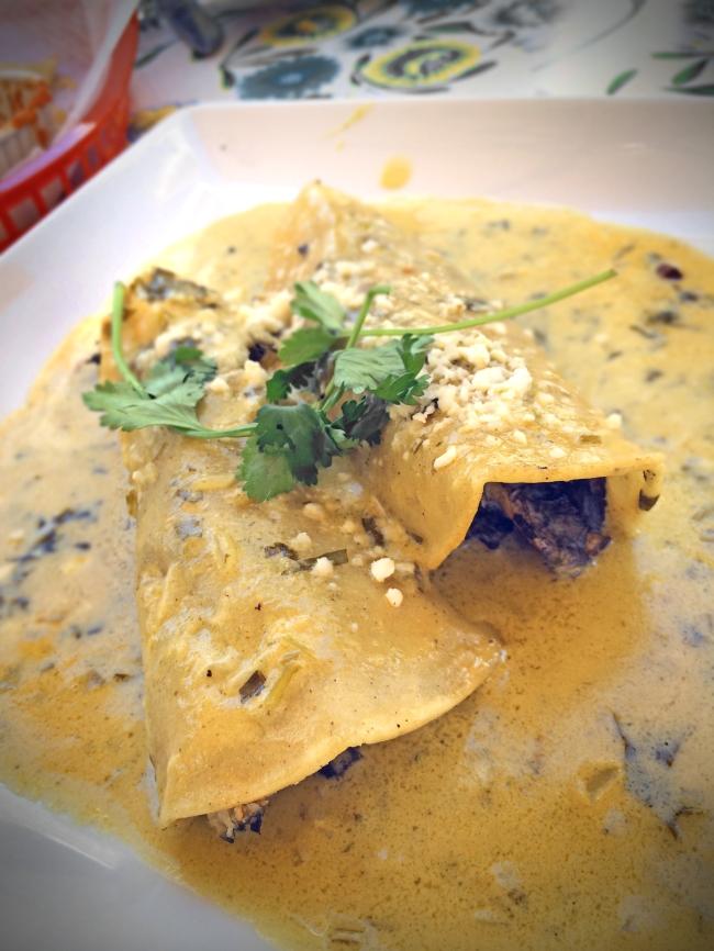 Crab &Huitlacoche Enchiladas: Two Dungeness crab &Huitlacoche (Black corn truffle) enchiladas topped with a citrus cilantro cream sauce