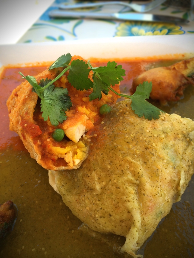 Flamenco Burrito: Paella style rice, Saffron, Lobster broth, Spanish chorizo, chicken, red bell pepper, onion Served wet half with fire roasted salsa and half with tomatillo verde salsa Served with deep fried avocado