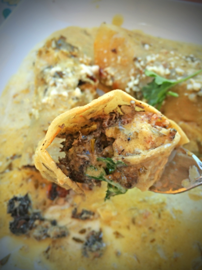 Crab &Huitlacoche Enchiladas: Two Dungeness crab &Huitlacoche (Black corn truffle) enchiladas topped with a citrus cilantro cream sauce