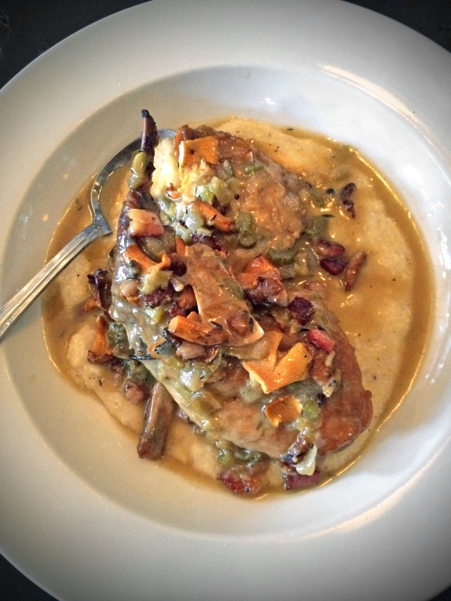Braised rabbit legs with pancetta, spin fossa polenta, Louisiana chanterelles and chard