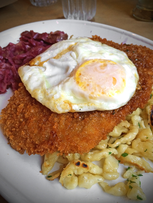 WIENER SCHNITZLE: VEAL CUTLET, SPATZLE, RED CABBAGE, CAPERS, PARSLEY, LEMON AND FRIED EGG