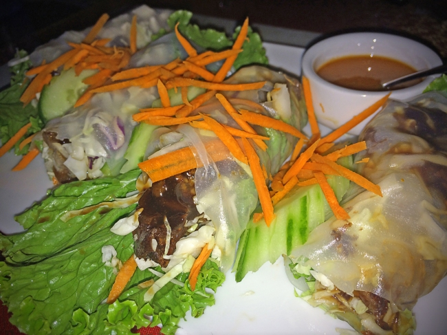 Crispy Duck Roll: crispy duck, cucumber, carrot and green leaf wrapped in rice noodles