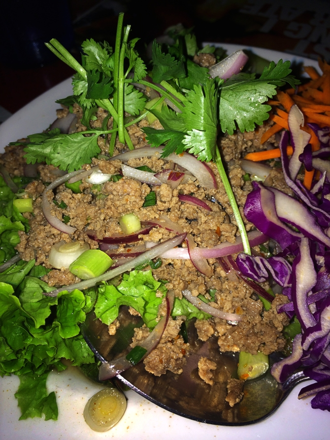 Larb: beef, flavored with fish sauce, lime juice, padaek, roasted ground rice and fresh herbs.