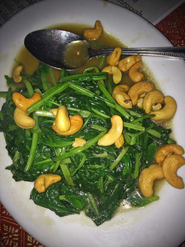 Spinach Flambé: stir fried spinach topped with cashew nuts