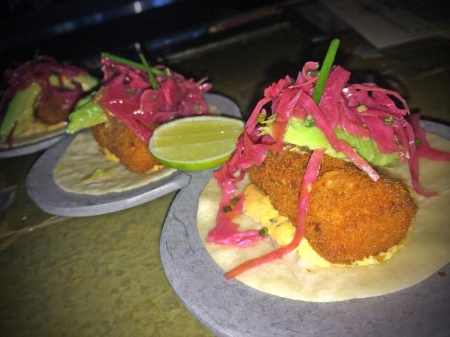 PESCADO CRISPY FISH, PICKLED RED CABBAGE, AVOCADO, CHIPOTLE