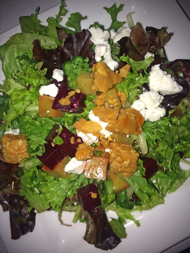 Roasted Beets: Roasted red and golden beets, baby greens, goat cheese, almond brittle