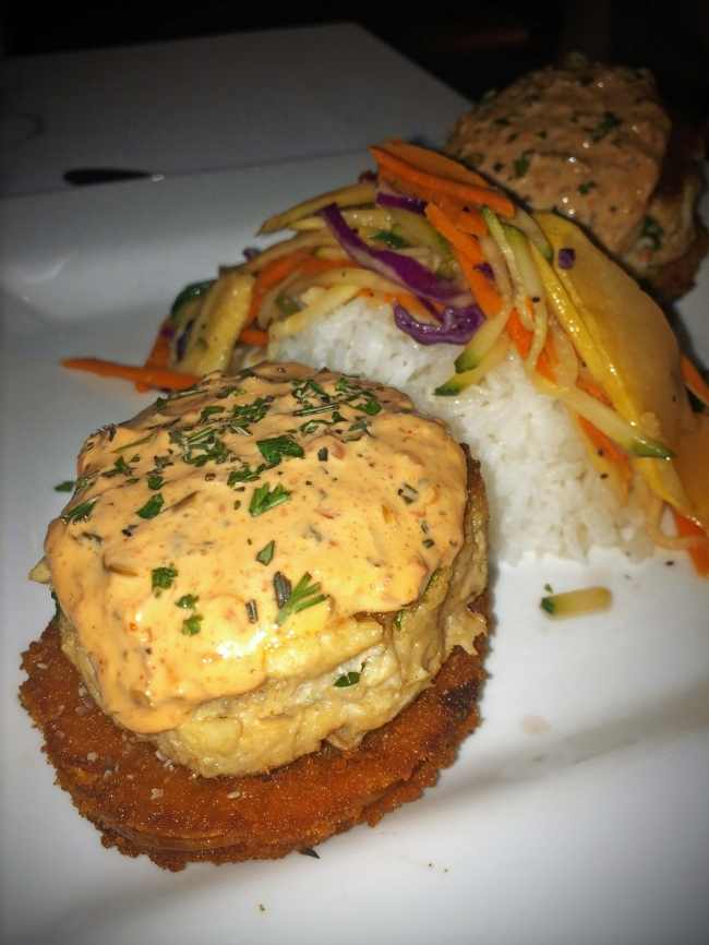 Crab Cakes: A‎ blend of local crab, fried green tomatoes and citrus caper aioli