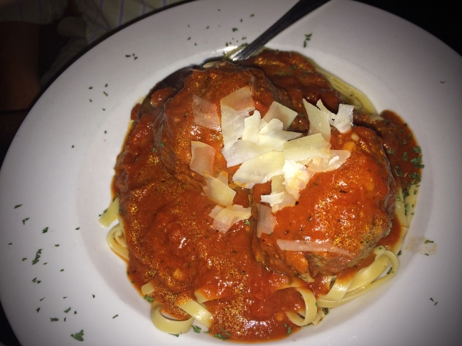 OLIVIAS MEATBALLS  Two 7 oz. homemade meatballs topped with our house marinara & shaved parmesan over pasta