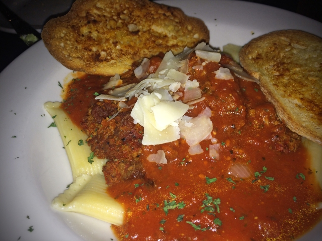 Rigatoni Bolognese  Ricotta cheese-stuffed jumbo rigatoni, topped with our homemade meat sauce & shaved parmesan, served with garlic bread