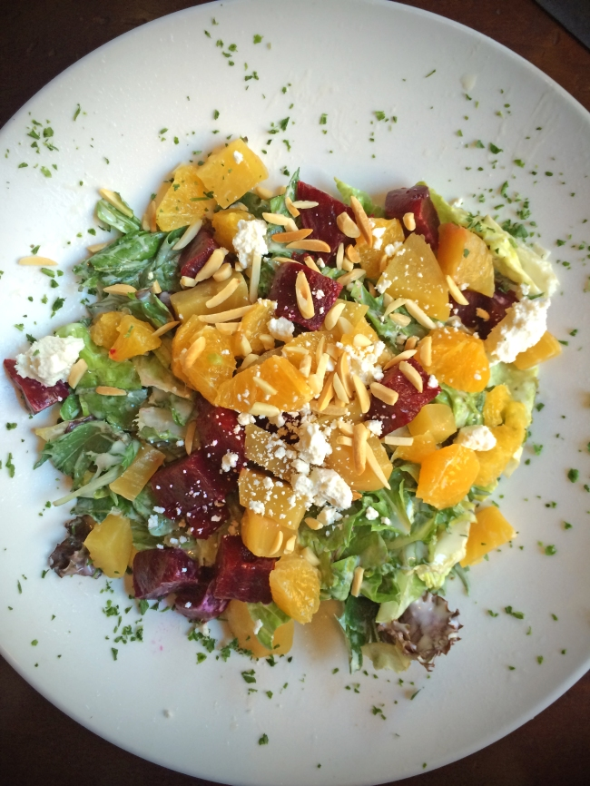 Beet and Goat Cheese: Roasted red and golden beets, orange segments, goat cheese, toasted almonds, mixed lettuce, Chef's creamy tarragon dressing.