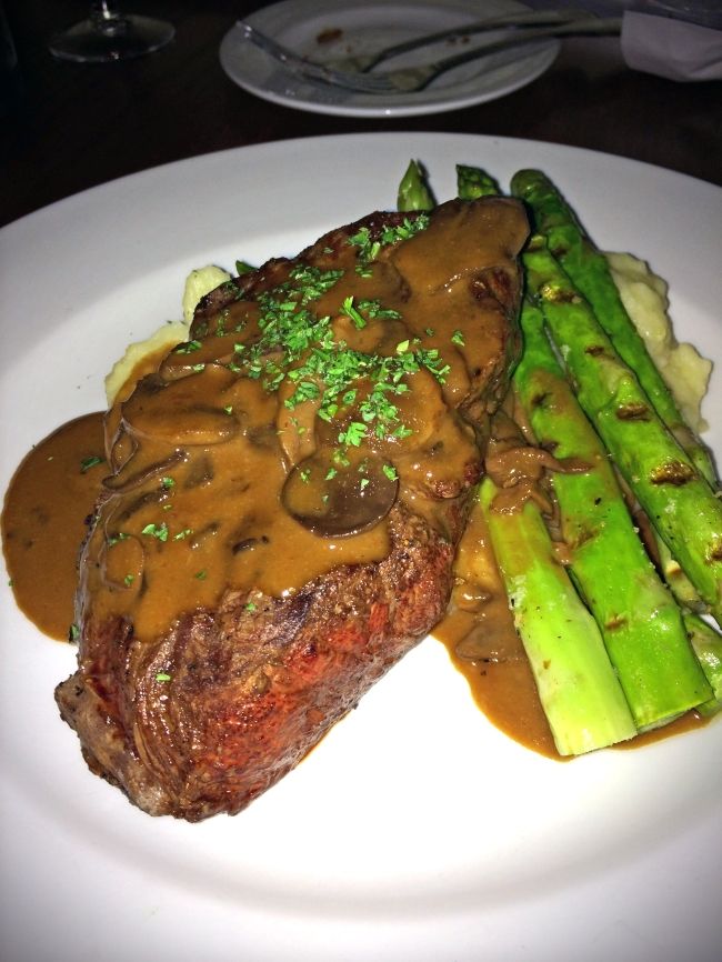 Steak Diane: Grilled Brandt all-natural 10 ounce flat iron steak, many mushrooms, brandy flambee, Dijon demi-glace, grilled asparagus and mashed Yukon gold potatoes