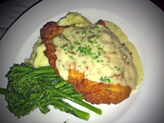 Buttermilk Herb Fried Chicken: Crispy fried buttermilk herb chicken, traditional cream gravy, mashed potatoes and buttered broccolini