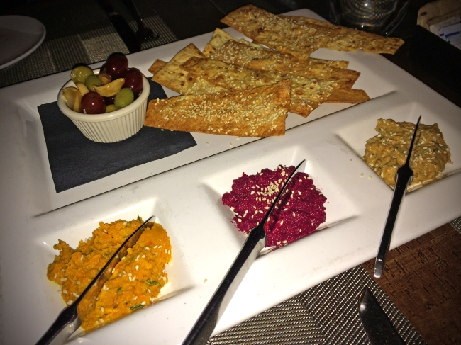 Mezze: carrot-garbanzo hummus, beet-walnut spread, roasted eggplant purée, sesame-lavash crackers