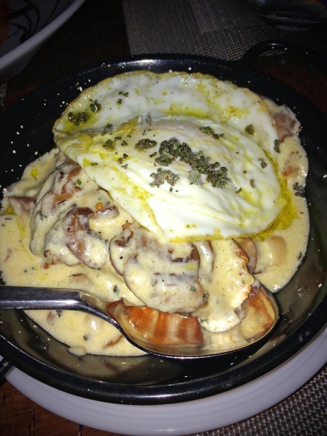 Bruschetta de la Boca: toasted bread w/ mushroom-manchego cream, fried egg & truffle oil