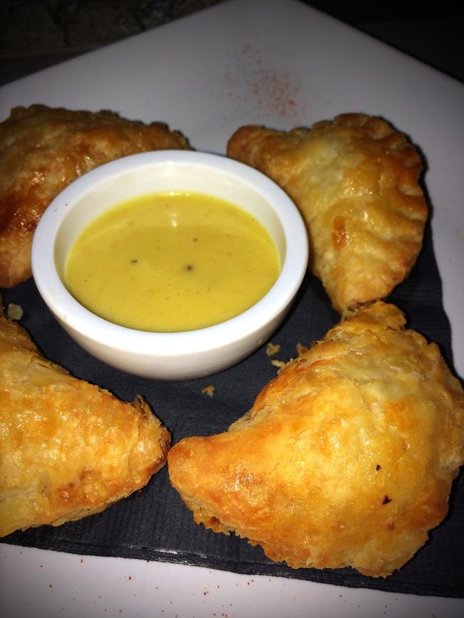 Chorizo Puffs with mustard sauce