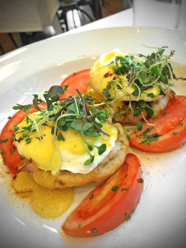 Creole Eggs Benedict tasso ham, buttermilk biscuits, heirloom tomatoes, petite herbs