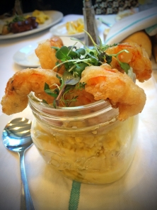 Eggs in a Jar fried shrimp, poached eggs, jalapeno cheese grits