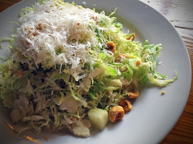Shaved Brussels Sprouts apples, pecorino romano, hazelnuts